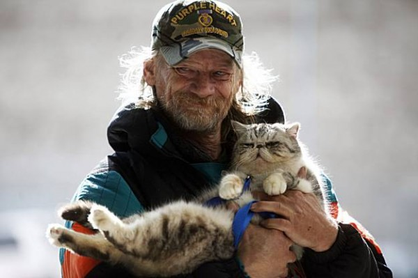 homeless man with cat