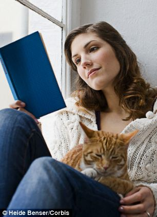 woman with book and cat