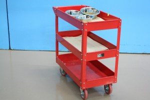 The bright red food cart we use to help feed and give water to our dogs.